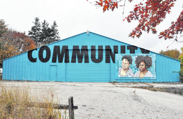A mural at the Second Ward Community Center on Ross Street in Delaware celebrates community in words and images. The City of Delaware has allocated $144,992 in CARES Act funding to the center.