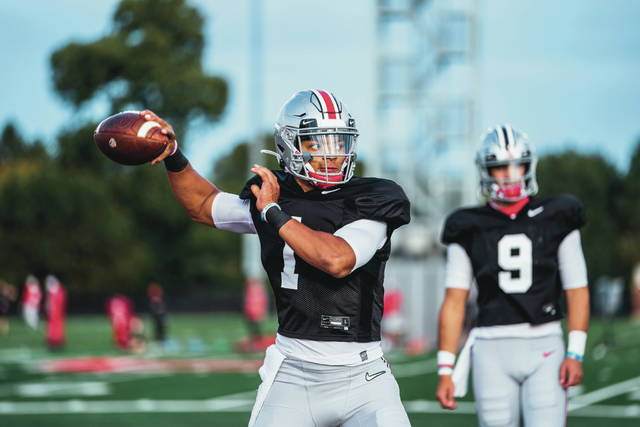 Ohio State quarterback Justin Fields drops back to pass during practice.