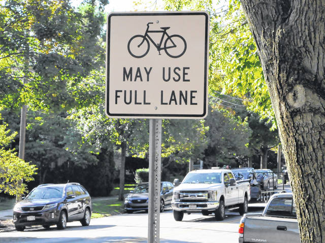 A sign posted on North Sandusky Street at the point where the bike lane ends just before the downtown area reminds those traveling on the roadway that bicyclists may use the entire lane.