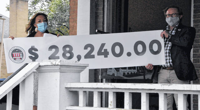 During Thursday's ceremony, Main Street Delaware Executive Director Susie Bibler and MSD Board President Zach Price held up a banner showing how much money MSD's Front Porch Campaign has raised to date to help renovate 20 E. William St. into a welcome center with public restrooms and a literal front porch for the community.