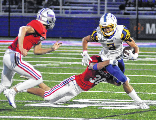 Olentangy senior Caleb Gossett fights for extra yardage during the second quarter of Friday night's showdown in Marysville.