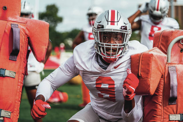 Ohio State sophomore defensive end Zach Harrison goes through a drill during practice.