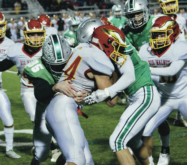 Big Walnut's Caden Williams fights for extra yardage during Friday's Division II, Region 7 playoff game against host Dublin Scioto.