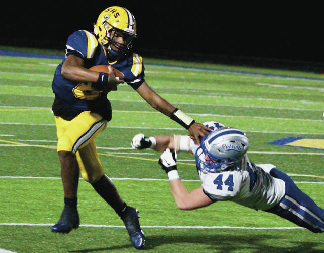 Springfield's Te'Sean Smoot eludes Olentangy Liberty's Josh Piela (44) during the first half of Friday's Division I, Region 2 final in Springfield.