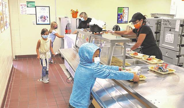 First grade students at Schultz Elementary School go through the lunch line Tuesday. Superintendent Heidi Kegley announced during Monday's board meeting that the U.S. Department of Agriculture has extended waivers giving students free lunch and breakfast through the end of the school year.