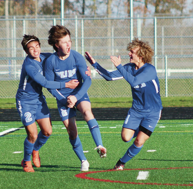 Olentangy Berlin's Mike Lapid (2), Gavin Kiener (12) and Luke Butzier celebrate after Kiener scored to put the Bears ahead to stay in Saturday's Division I district championship against visiting Westerville Central.
