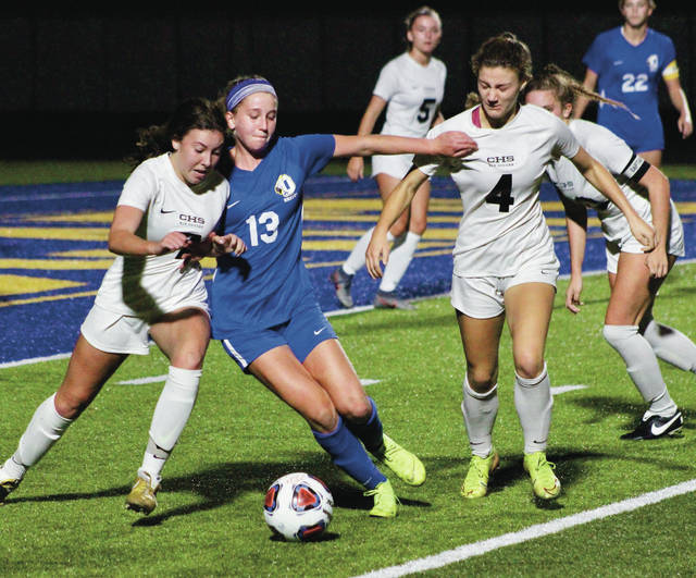 Olentangy's Audrey Oliver battles with Centerville's Braelen Devoe, left, and Molly Wiedemann during the first half of Tuesday's Division I state semifinal in Springfield.