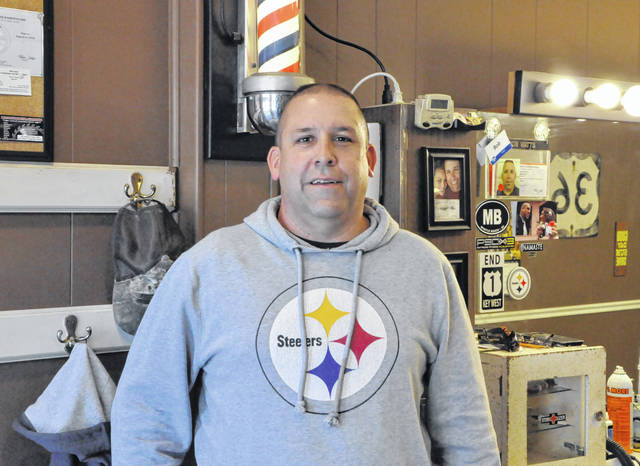 Bob Watts, a U.S. Navy veteran and owner of Sandusky Street Barber Shop in downtown Delaware, has teamed with Arbors at Delaware to give back to local vets. Watts is pictured inside his shop at 28 S. Sandusky St.