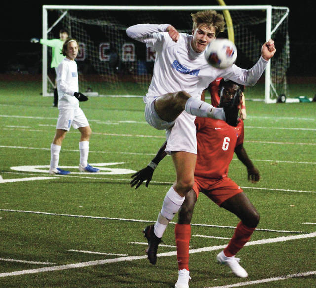 Olentangy Berlin's Lincoln Ulrich tries to gain possession in front of Thomas Worthington's Caleb Opoku (6) during the first half of Wednesday's Division I regional semifinal.