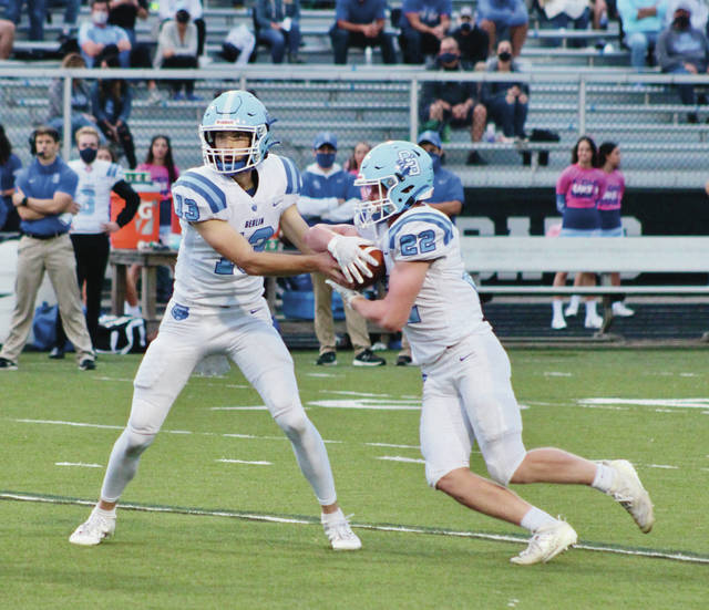Olentangy Berlin quarterback Jacob Moeller hands off to Gavin Angell during the first half of a Division II regional quarterfinal against host Westerville South last month. Moeller threw for 2,823 yards and 24 touchdowns for the Bears, who finished 5-4 with a pair of playoff wins.