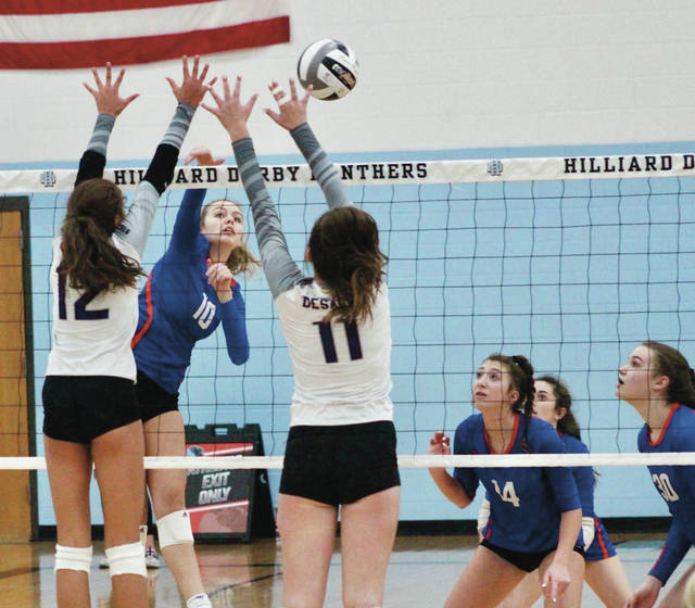 Olentangy Orange's Olivia McAtee (10) hits a shot past DeSales' Gabbi D'Amico (12) and Morgan Tydings (11) during the first set of Thursday's Division I regional semifinal at Hilliard Darby.