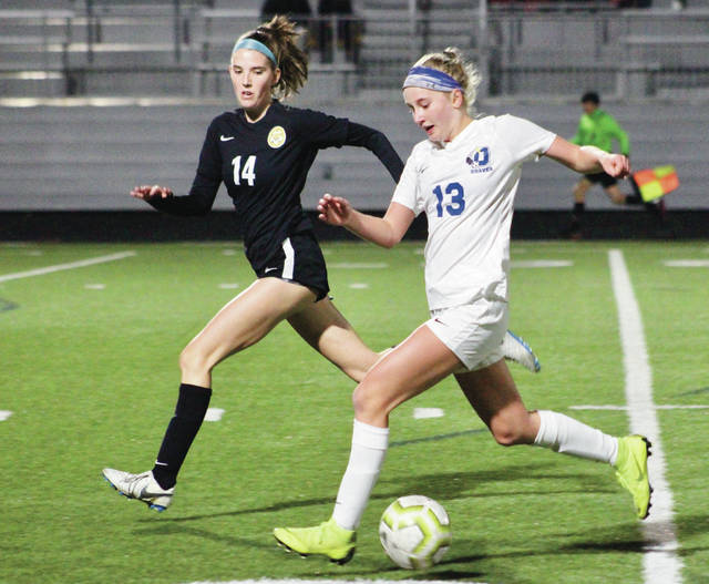 Olentangy's Audrey Oliver (13) races past Upper Arlington's Bailey Farrell during the first half of Tuesday's Division I regional semifinal in Upper Arlington.