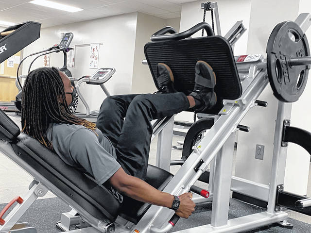 Aaron Lees, a student in the Delaware Area Career Center's Exercise Science program, does a leg workout. The program will be one of the many programs that prospective students can learn about during the DACC's Virtual Open House event on Dec. 10.