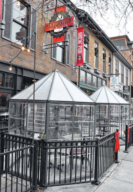 The patio outside Restoration Brew Worx in downtown Delaware is now home to two heated huts.