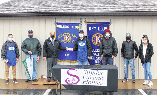 Pictured, left to right, are Kiwanis members Doyle Webb and Jack Hilborn, Clay Snyder (Snyder Funeral Homes), Ed Schlote (Kiwains), and Key Club members Cole Stojkov, Gavin Froelich and Emma Ralph.