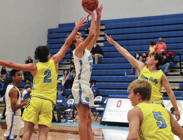 Olentangy Berlin's Derek Goodman shoots between a trio of River Valley defenders during the first half of Tuesday's non-league showdown in Delaware.
