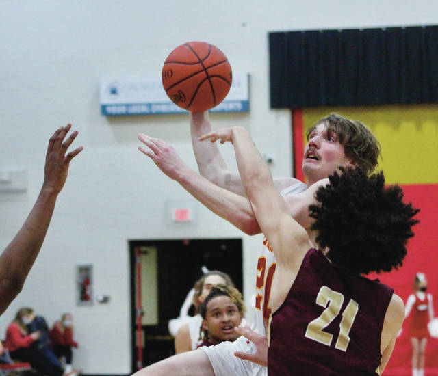 Big Walnut's Troy Musser shoots over Licking Heights' Dante Collier (21) during the first half of Tuesday's non-league showdown in Sunbury.