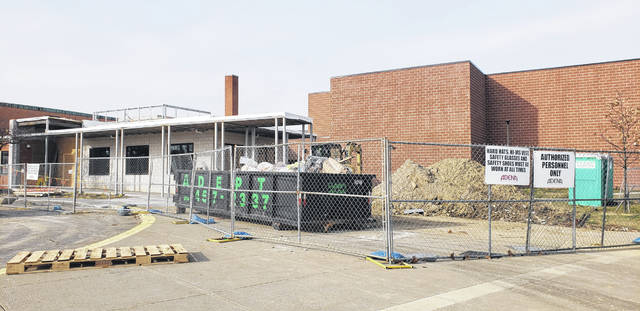 Construction on the front of Carlisle Elementary in Delaware nears completion Tuesday. The renovation project consists of new office space and a lobby, as well as additional classrooms.
