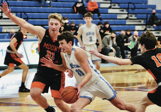 Olentangy Berlin's Jason Inbody (11) drives to the hoop against Mount Vernon's Beau Bridges during the second half of Wednesday's non-league showdown in Delaware.