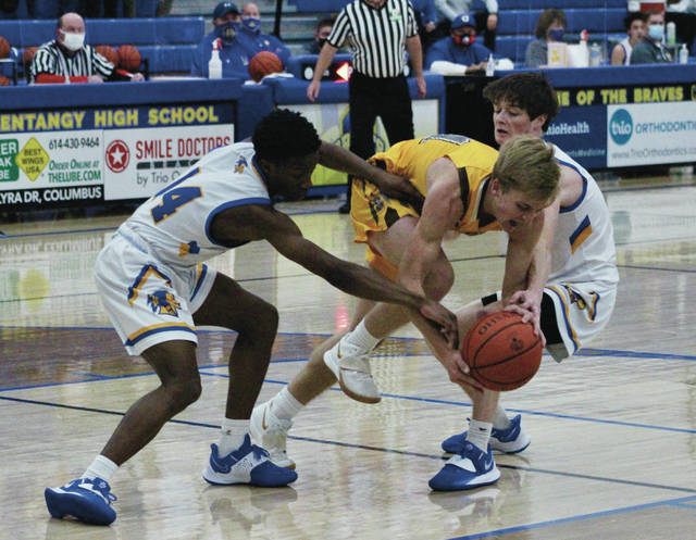 Olentangy's Gideon Alabi, left, and Ethan Smith, pressure Buckeye Valley's Owen Osborne during the first half of Saturday's season opener in Lewis Center.