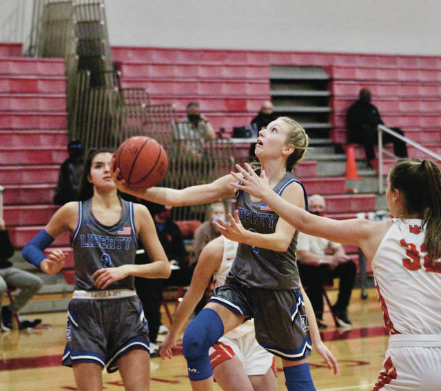 Olentangy Liberty's Caitlin Splain drives in for a layup during the first half of Friday's non-league showdown against host Worthington Christian.