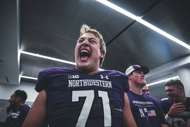 Northwestern offensive lineman Ben Wrather, an Olentangy Liberty graduate, celebrates with his teammates after a win earlier this season.