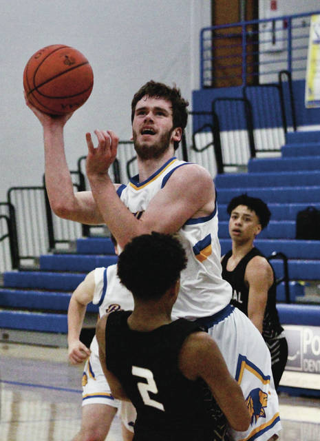 Olentangy's Zach Wieging puts up a shot over Westerville Central's Landon Tillman (2) during the first half of Wednesday's non-league showdown in Lewis Center.