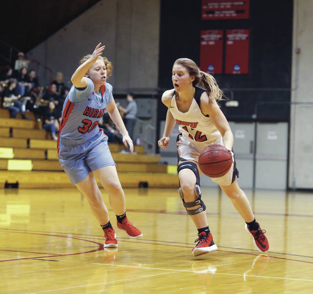 Ohio Wesleyan's Molly Delaney, right, an Olentangy graduate, drives toward the hoop during a game last season at Branch Rickey Arena.