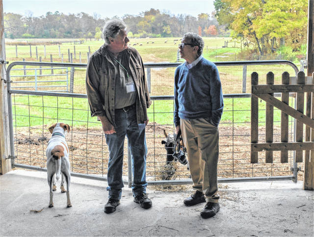 Jeff Dickinson, left, speaks to Ohio Gov. Mike DeWine, right, during DeWine's visit to the Stratford Ecological Center in October 2019.