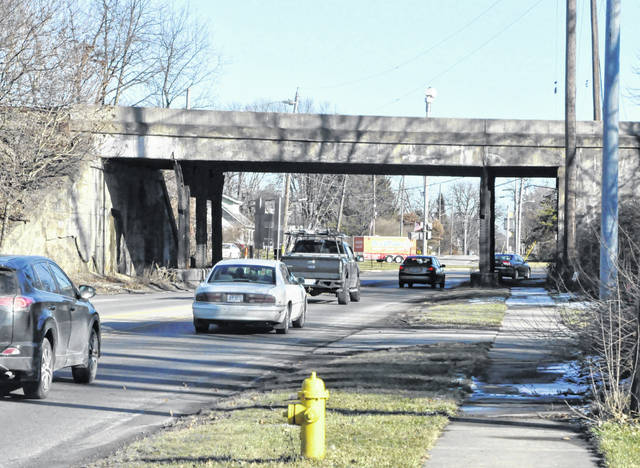 Vehicles travel under the railroad underpass at The Point intersection, where U.S. Route 36 and state Route 37 meet on the east side of Delaware.