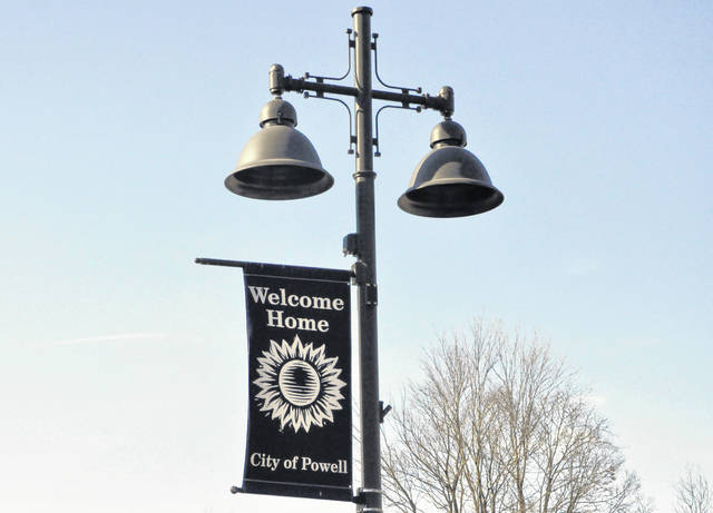 "Pictured is a ""Welcome Home"" banner displayed on a light pole outside the City of Powell Municipal Building at 47 Hall St."