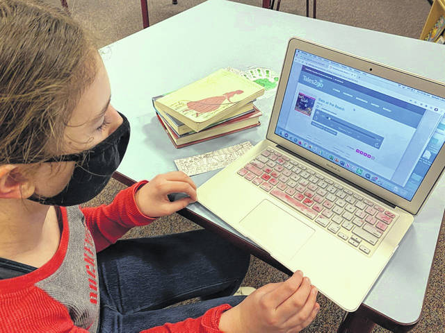 Savanna Schneider, a fourth grader at Schultz Elementary School, listens to an audiobook on Tales2Go, a subscription service available to all elementary school students.
