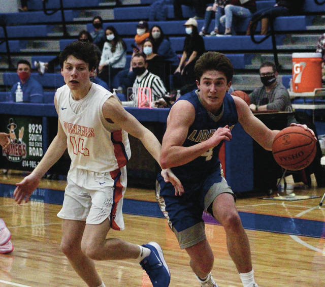 Olentangy Liberty's Cam Barcus, right, drives past Olentangy Orange's Mikey McCollum during the second half of Friday's OCC-Central showdown in Lewis Center.
