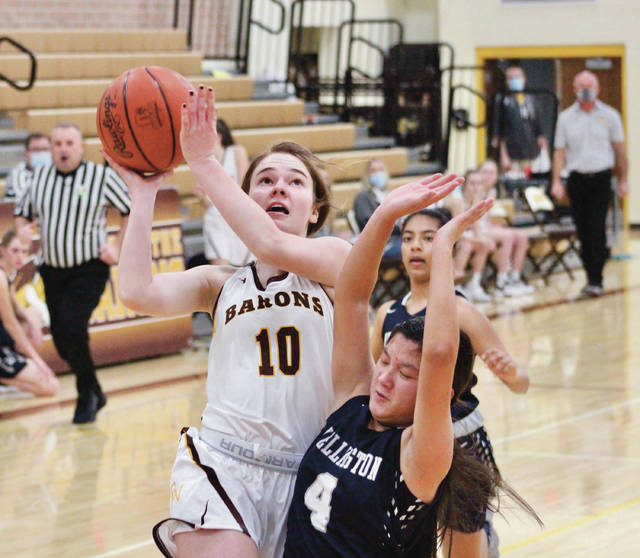 Buckeye Valley's Vivian Leatherman (10) puts up a shot over Wellington's Abigail Burkhardt (4) during the first half of Tuesday's MSL-Ohio opener in Delaware.