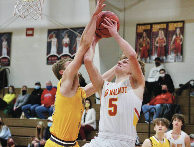 Big Walnut's Caleb Conard puts up a contested shot against Buckeye Valley's Jake Radcliffe during the first half of Thursday's non-league showdown in Sunbury.