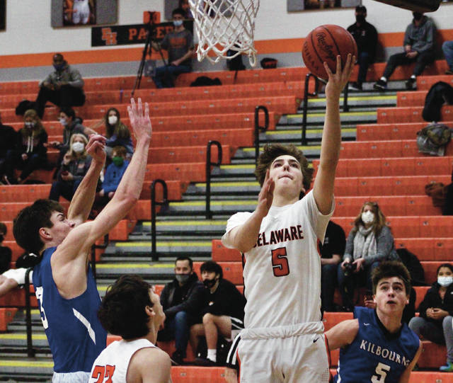 Delaware Hayes' Jacob Enke puts up a shot during the first half of Friday's OCC-Capital clash against visiting Worthington Kilbourne.