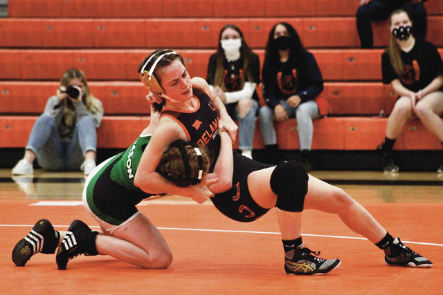 Delaware Hayes' Molly Wells, right, battles for control against Mason's Haley Williams during Wednesday's dual in Delaware.