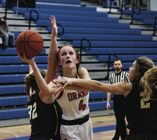 Olentangy Orange's Mairin O'Brien puts up a shot between two Lancaster defenders during the first half of Tuesday's non-league showdown in Lewis Center.