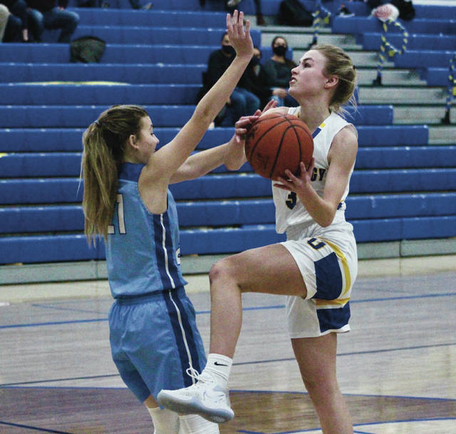 Olentangy's Meg Spohn, right, shoots over Olentangy Berlin's Jocelyn Franz during the first half of Friday's OCC-Cardinal Division showdown in Lewis Center.