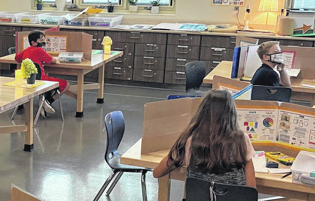 Students at Buckeye Valley West Elementary School work on an assignment. Students have been on a four-day learning model, but the Buckeye Valley Board of Education voted Thursday to return to five-day in-person learning beginning March 22.