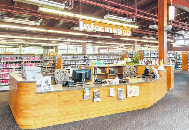 Pictured is the information desk inside the Orange Branch Library at 7171 Gooding Blvd. in Delaware.