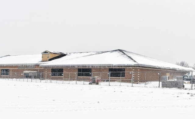Schultz Elementary School sits empty Monday afternoon after the weekend's snowfall caused Delaware City Schools to cancel classes.