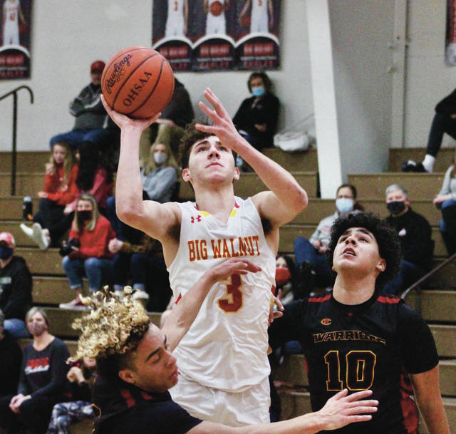 Big Walnut's Jared Kreager (3) puts up a shot between a pair of Westerville North defenders during the first half of Thursday's league showdown in Sunbury.