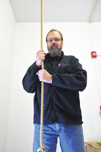 Rex Welker rings the bell at First Presbyterian Church, located at 73 W. Winter St. in Delaware.
