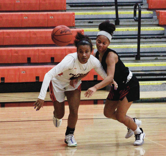 Hayes' Myah Byers, left, beats Westerville South's Lauryn Swanson to a loose ball during the first half of Tuesday's OCC-Capital Division showdown in Delaware.