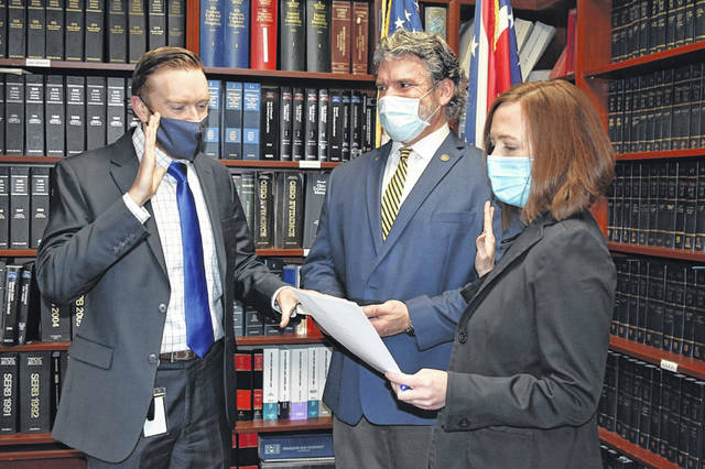 Special Victims Prosecutor Cory Goe (left) is sworn in by Delaware County Prosecutor Melissa Schiffel and investigator Bob Peterson. Goe worked at the office from 2014-2018 and prosecuted a variety of felonies in Delaware County Common Pleas Court before taking a position at the Ohio Attorney General's Office.