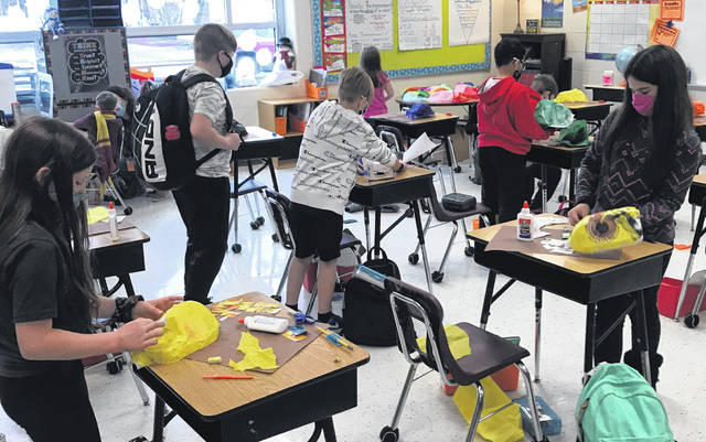 Fourth graders at Smith Elementary School in Delaware work on an assignment. The DCS Board of Education discussed moving to the traditional all-in model Tuesday but elected to remain on the hyrbid schedule for the rest of the school year.