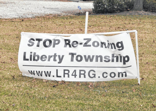 A sign displayed in front of a home on Liberty Road has urged the powers to be to stop rezoning Liberty Township. On Monday, trustees approved the rezoning of land along Sawmill Parkway.
