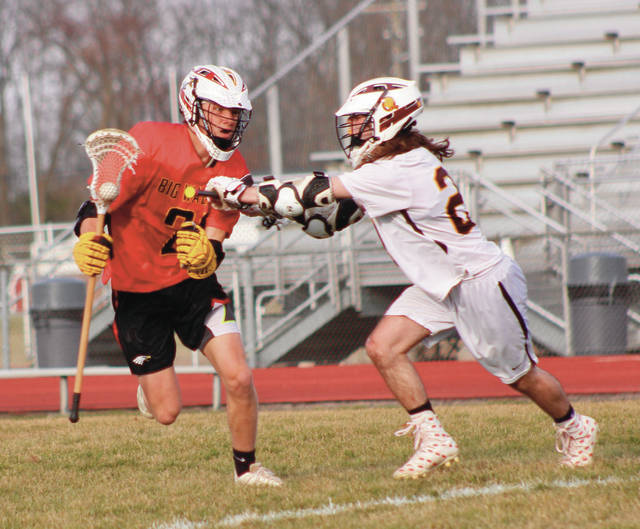 Big Walnut's Jakob Ambrose, left, is defended by Buckeye Valley's Nolan Pienta during the first quarter of Tuesday's season opener in Delaware.