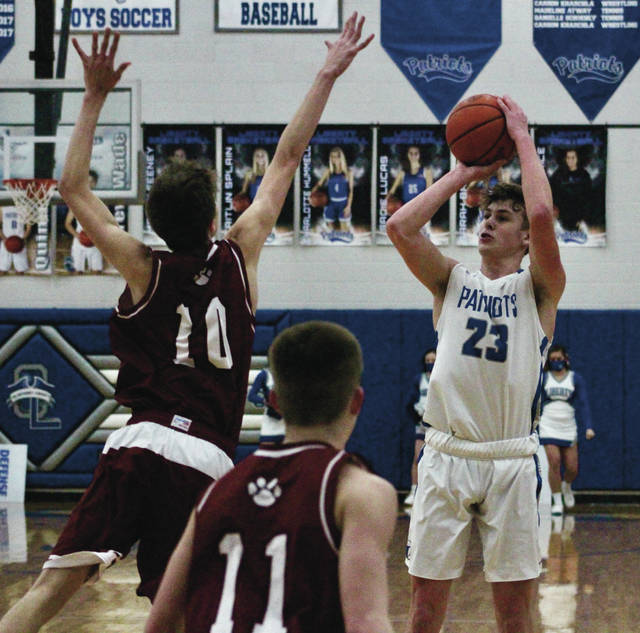 Olentangy Liberty's Cooper Davis (23) shoots over Newark's Ethan Schell (10) during the first half of Saturday's Division I district final in Powell.